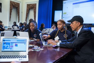 """President Barack Obama, works with a middle-school student who is participating in an """"Hour of Code"""" event to honor Computer Science Education Week, in the Room 430 of the Eisenhower Executive Office Building, Dec. 8, 2014. (Official White House Photo by Pete Souza)"""